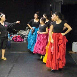 Ms. Erika instructing the Mexican Folkloric class