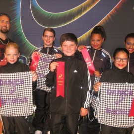 Ernie Calderon and the Hip Hop Crew Company after a competition win
